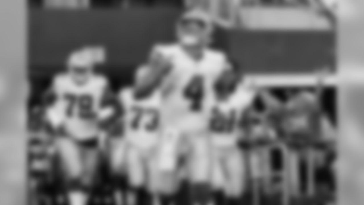 Dallas Cowboys quarterback Dak Prescott (4) runs onto the field before a preseason NFL Football game against the Cincinnati Bengals in Arlington, Texas, Saturday, Aug. 18, 2018. (AP Photo/Roger Steinman)