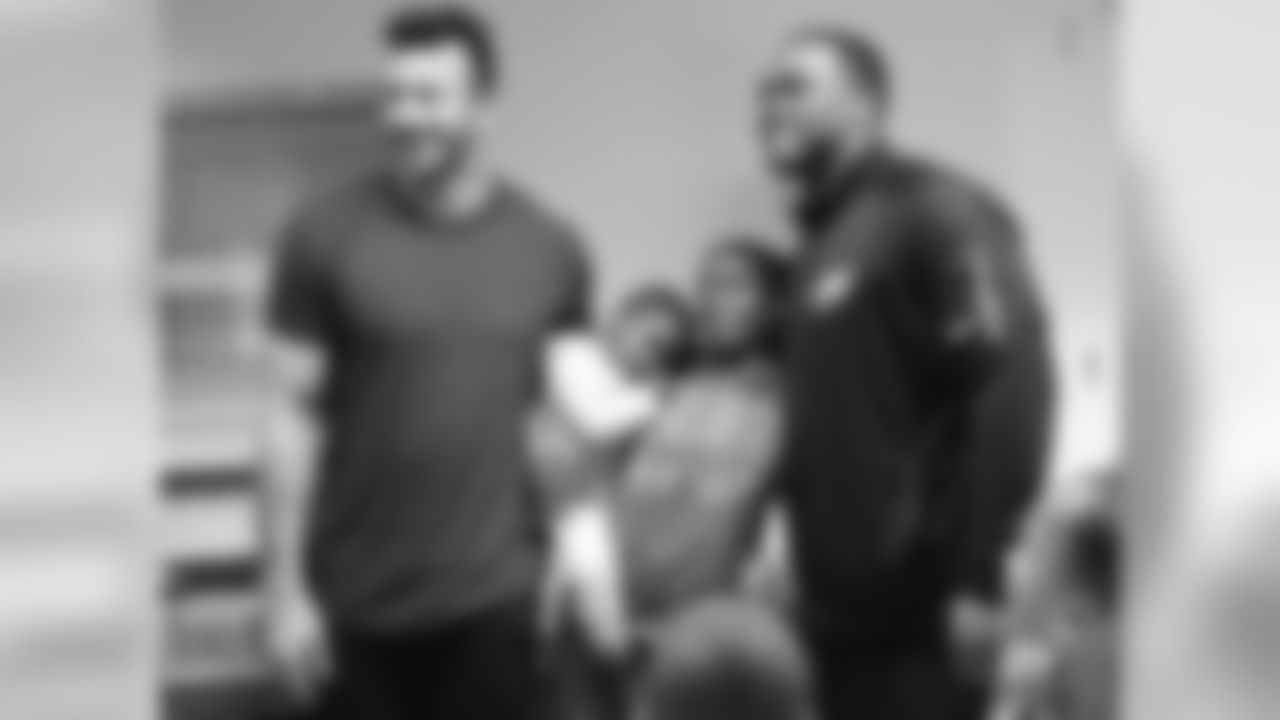LBs Connor Barwin and Brandon Graham visited with families at Wesley House on Monday morning