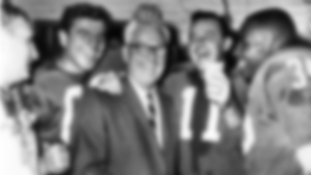 Chuck Bednarik, Coach Buck Shaw, Norm Van Brocklin, and Ted Dean celebrate their victory over the Green Bay Packers.