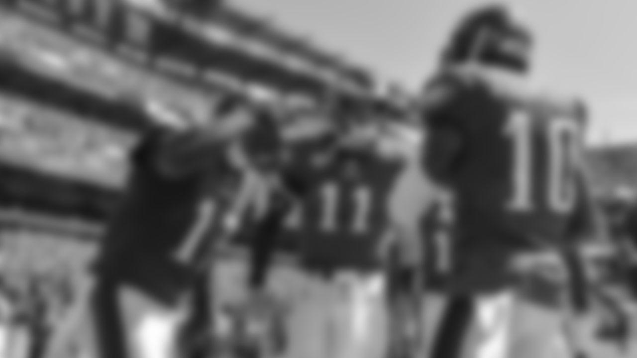 WRs Alshon Jeffery and DeSean Jackson celebrate with QB Carson Wentz following a touchdown