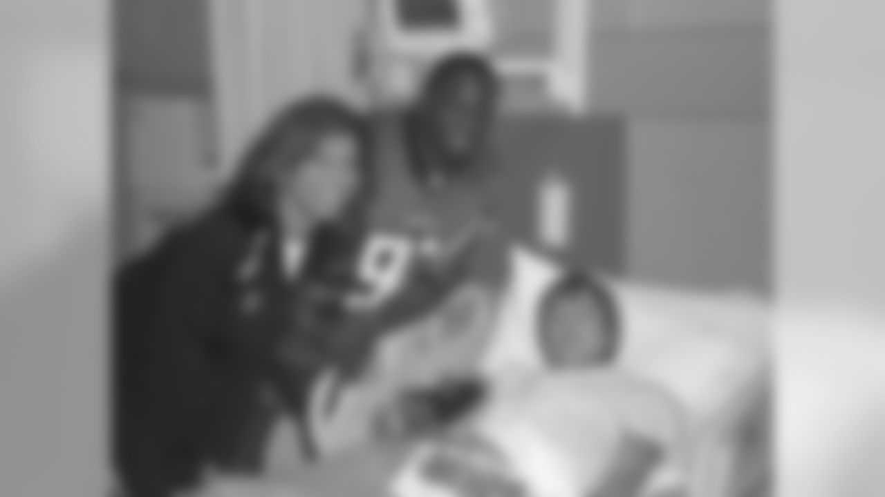 The Atlanta Facons visit Children's Healthcare of Atlanta  //  Atlanta, GA //  Chauncey Davis visiting a patient //