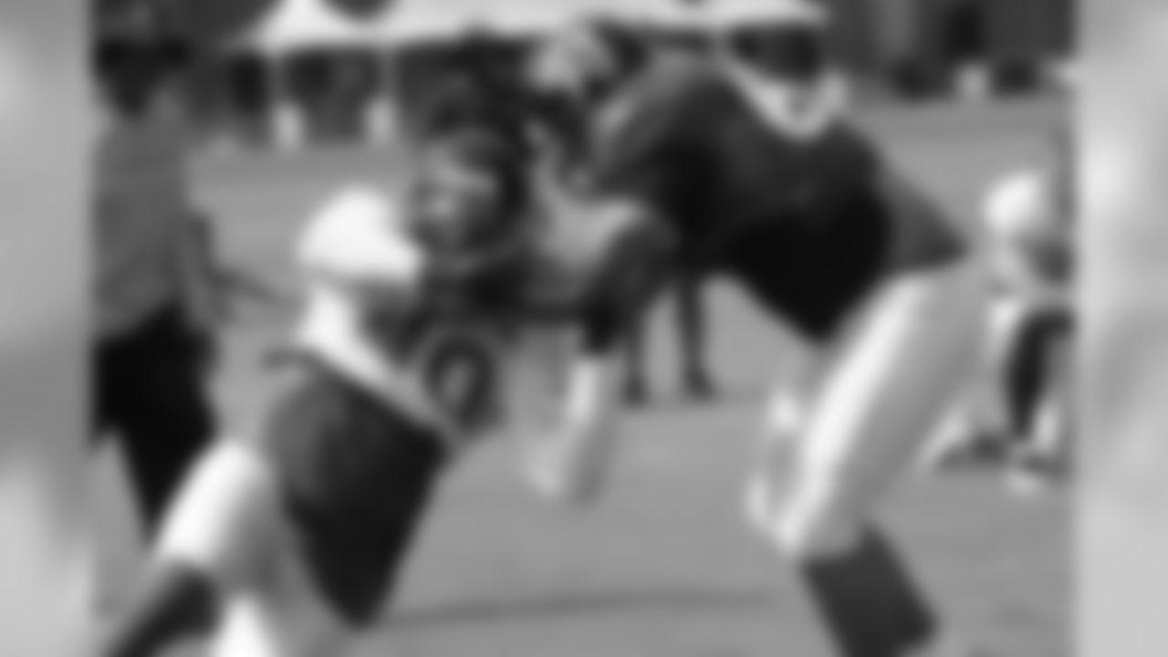 OL Jose Valdez, right, blocks DE Lawrence Sidbury // 2011 Russell Athletic Training Camp - Day 4 // August 1, 2011 // Flowery Branch, Ga. —