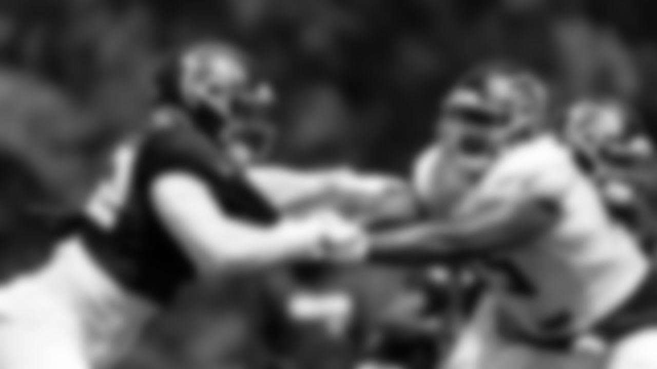 Atlanta Falcons linebacker Adetokunbo Ogundeji #92 and offensive tackle Kion Smith #75 run a drill during AT&T Atlanta Falcons Training Camp at Atlanta Falcons Headquarters in Flowery Branch, Georgia, on Thursday August 26, 2021. (Photo by Dakota Williams/Atlanta Falcons)