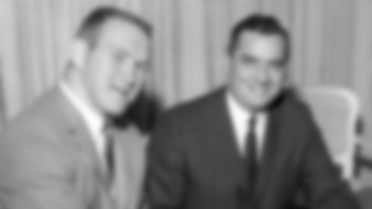 In this Dec. 14, 1965, file photo, All-America Texas linebacker Tommy Nobis, left, and Rankin Smith, owner of the Atlanta Falcons of the National Football League announce Nobis' signing of a contract with the team in Austin, Texas on Dec. 14, 1965. (AP Photo/File)
