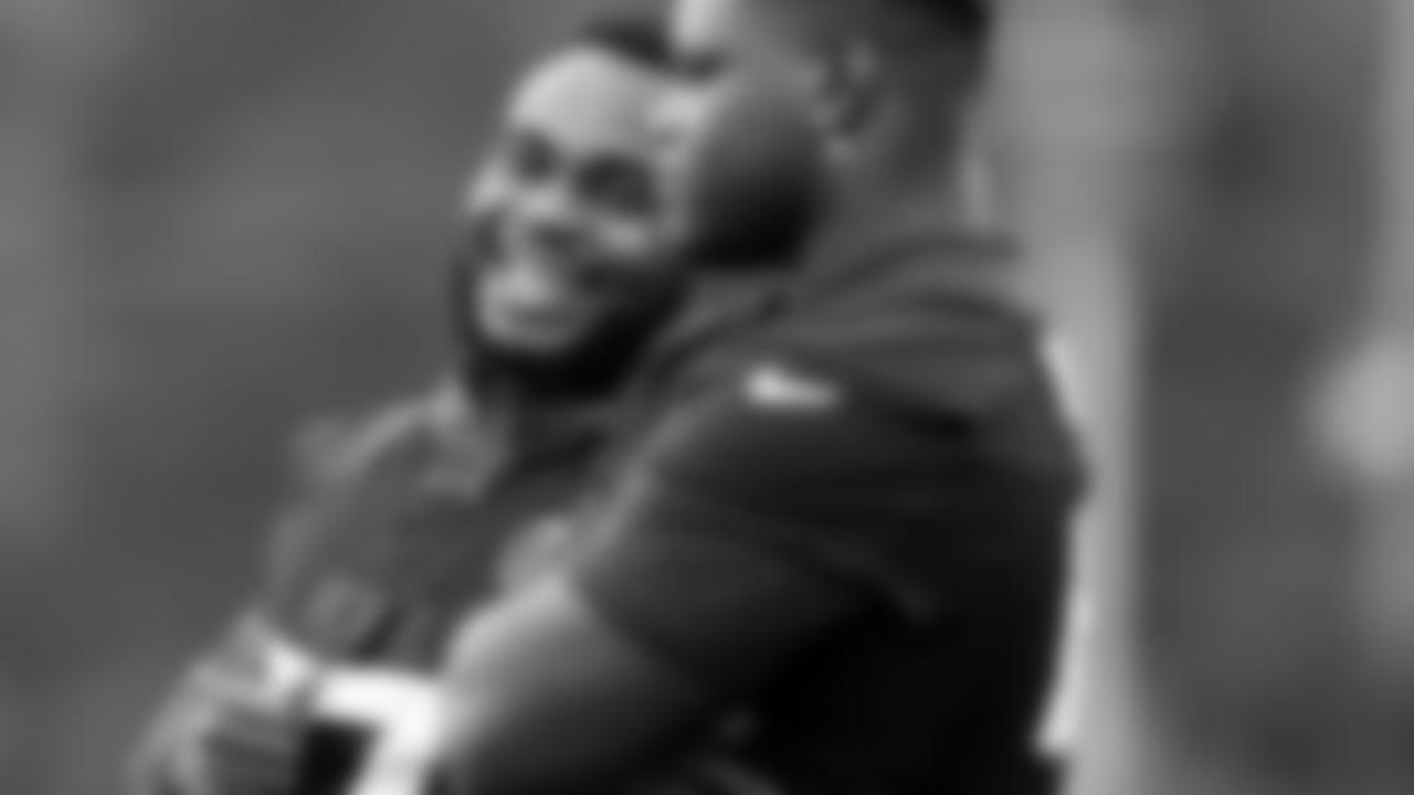 Atlanta Falcons defensive tackle Grady Jarrett #97 laughs at defensive end Marlon Davidson #90 during field work drills in Phase II of the Atlanta Falcons offseason program on May 18, 2021.