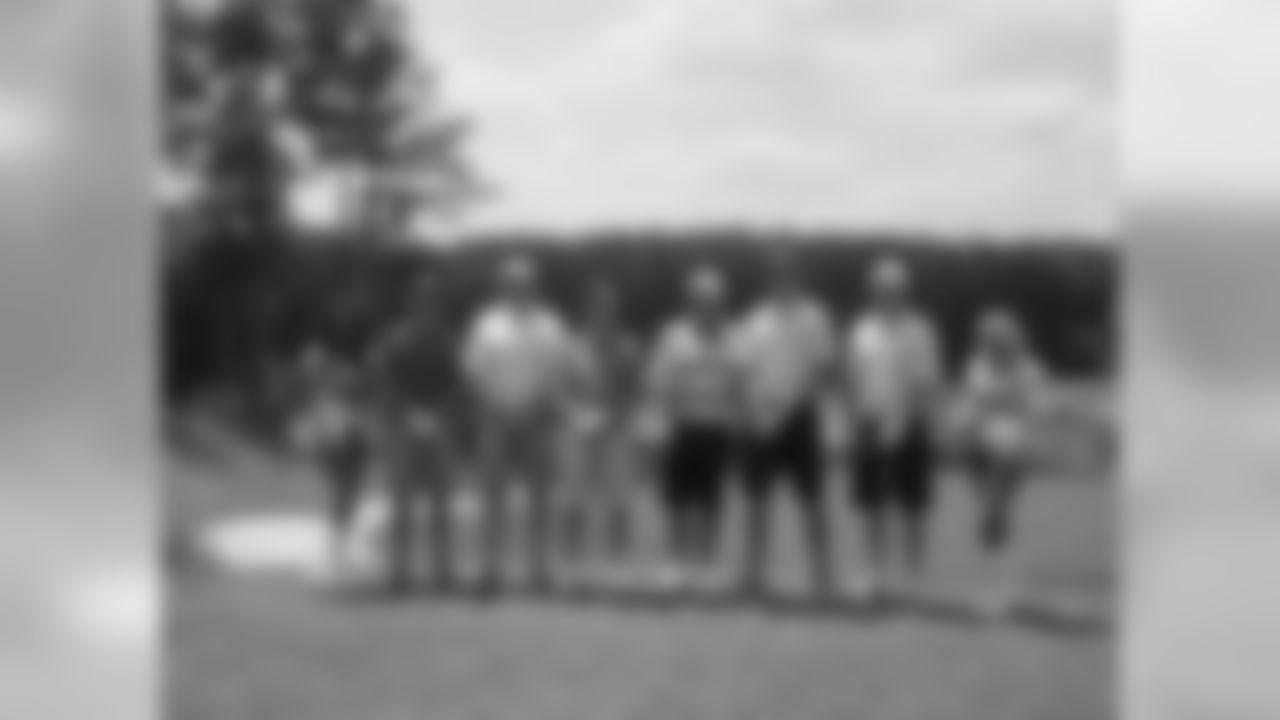 QB Matt Ryan and his group pose with head coach Mike Smith at the 17th tee // Verizon Wireless Network of Champions Golf Tournament - 2012 // June 18, 2012 // Suwanee, Ga., -
