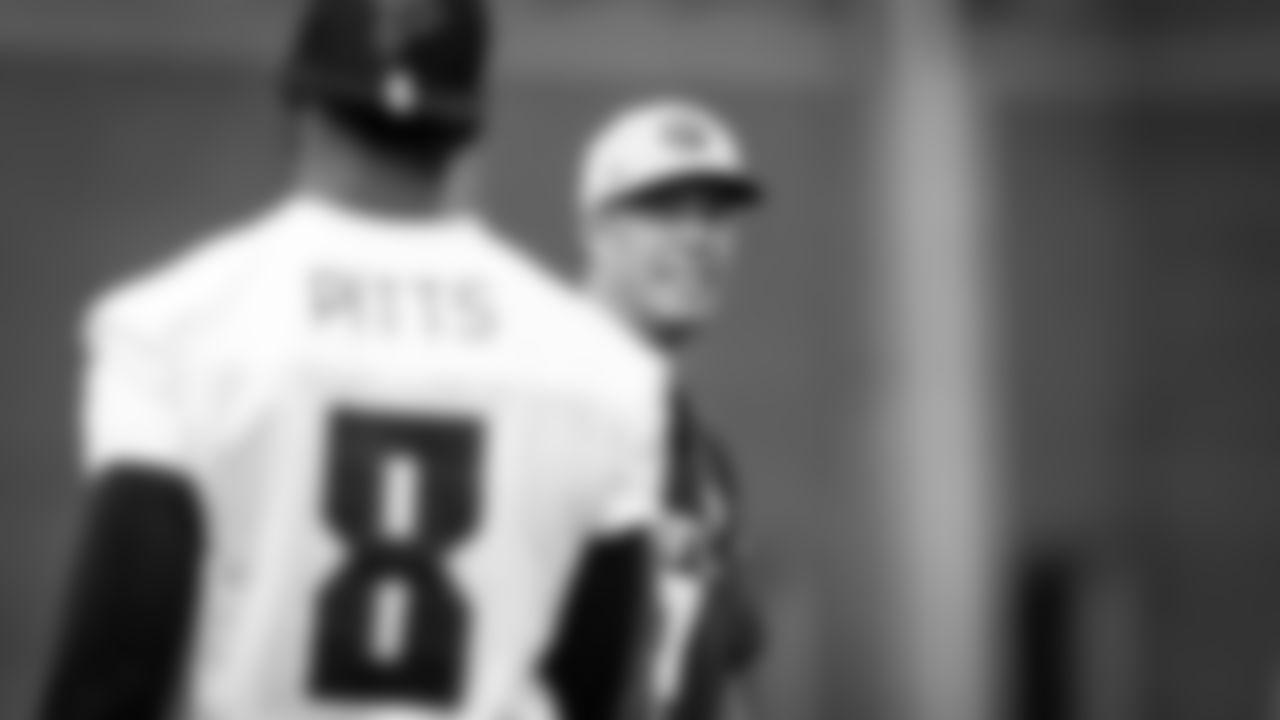 Atlanta Falcons quarterback Matt Ryan #2 talks to tight end Kyle Pitts #8 during field work drills in Phase II of the Atlanta Falcons offseason program on May 18, 2021.