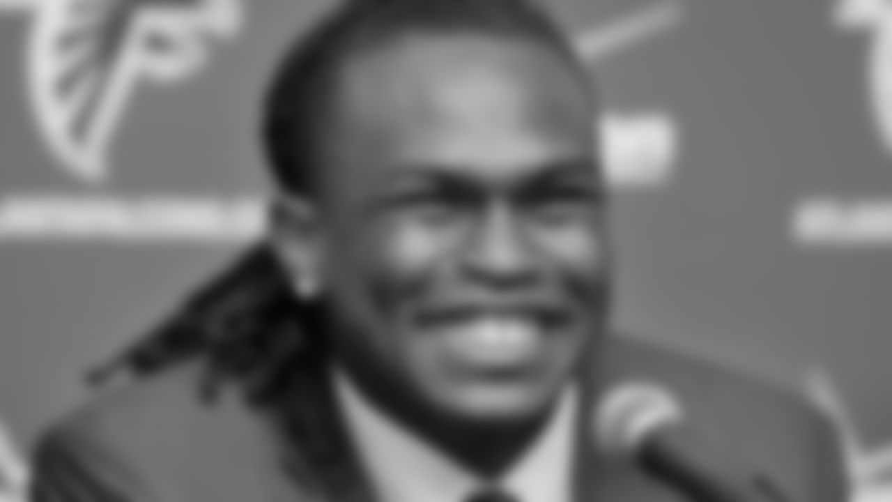 The Atlanta Falcons first-round draft selection, wide receiver Julio Jones, shares a laugh after being introduced during a news conference on Friday, April 29, 2011, at the Falcons Training Facility in Flowery Branch, Ga. (AP Photo/Gregory Smith)