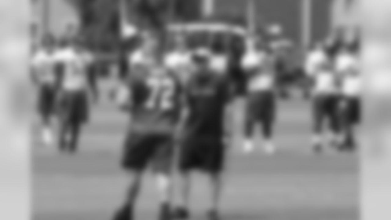 OT Sam Baker taking the field for practice