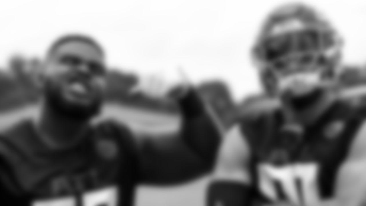 Atlanta Falcons defensive tackle Grady Jarrett #97 and Atlanta Falcons outside linebacker Jacob Tuioti-Mariner #91 during organized team activities in Phase III of the Atlanta Falcons offseason program on June 3, 2021.