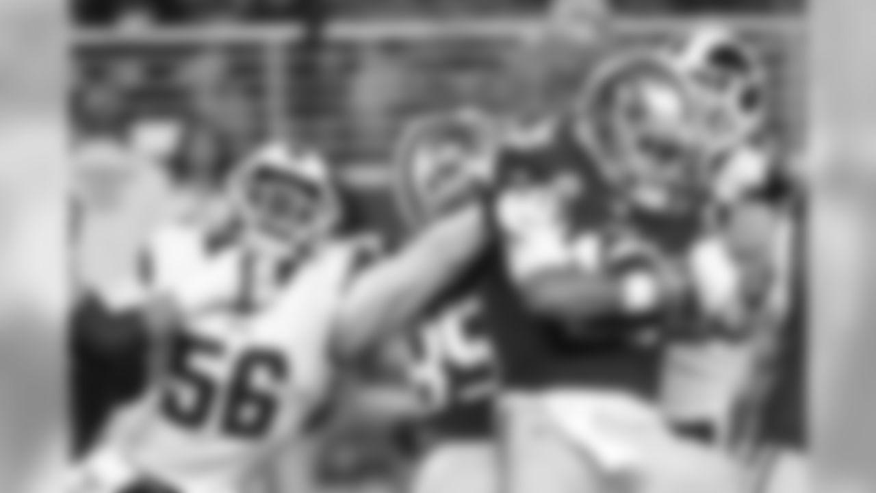 Los Angeles Rams linebacker Dante Fowler Jr. (56) sacks San Francisco 49ers quarterback Jimmy Garoppolo (10) during an NFL game, Saturday, Dec. 21, 2019, in Santa Clara, Calif. The 49ers defeated the Rams 34-31. (Kevin Terrell via AP)