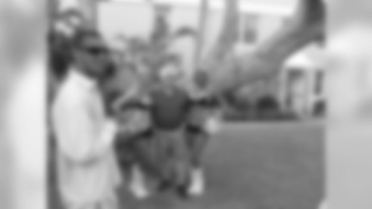 Natalie B. and Jonna B. pose with guests at the meet and greet // Atlanta Falcons Cheerleaders Bermuda Meet and Greet // 5/27/11 // Bermuda -
