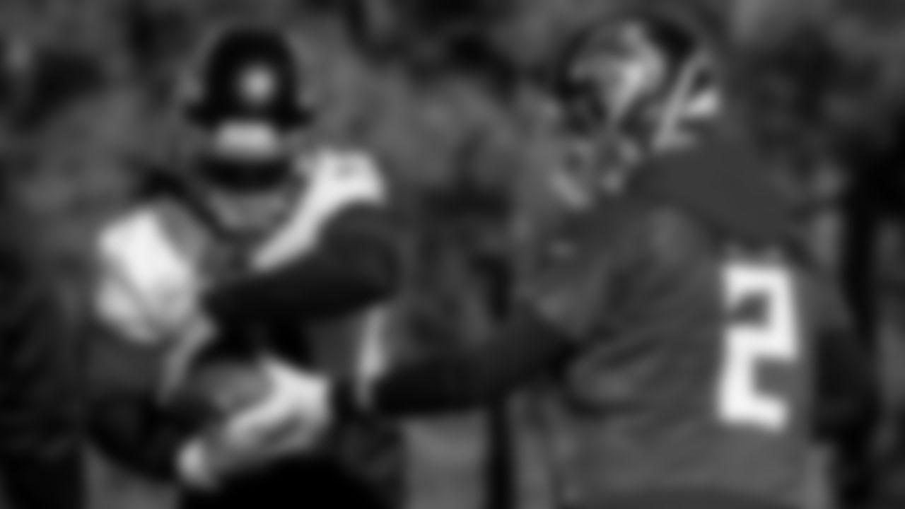 Atlanta Falcons quarterback Matt Ryan #2 hands off to running back Todd Gurley #21 during practice at IBM Performance Field.