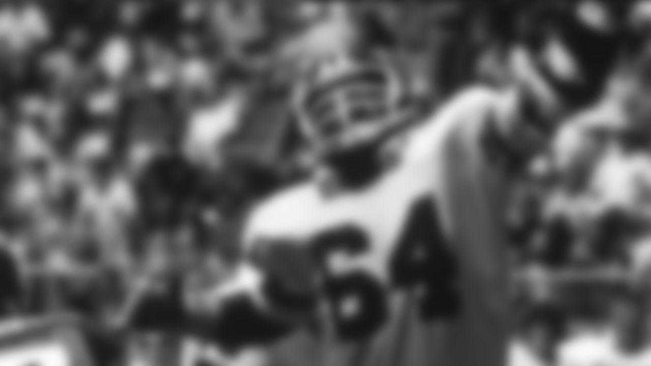 John Mendenhall (64) of the New York Giants defends a pass by Ron Jaworski (7) of the Philadelphia Eagles during the Giants 23-17 loss to the Philadelphia Eagles at Veterans Stadium in Philadelphia, PA on September 2, 1979.
