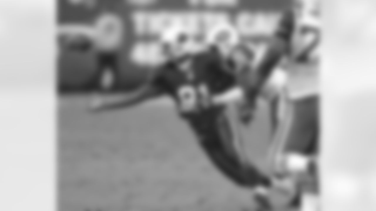 Arizona Cardinals' Anquan Boldin fumbles the ball as New York Jets' David Barrett (36) defends during the fourth quarter Sunday, Nov. 28, 2004 at Sun Devil Stadium in Tempe, Ariz. The Jets won 13-3. (AP Photo/Matt York)