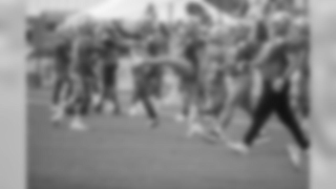 Detroit Lions quarterback Matthew Stafford (9) stretches before training camp practice on Thursday, Aug. 16, 2018 in Allen Park, Mich. (Detroit Lions via AP)