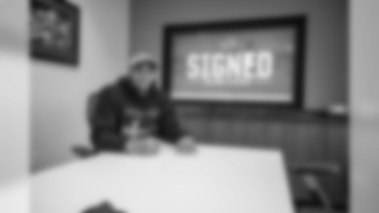 Detroit Lions defensive end Trey Flowers signs a free-agent contract at the Detroit Lions training facility on Thursday, March 14, 2019 in Allen Park, Mich. (Detroit Lions via AP)