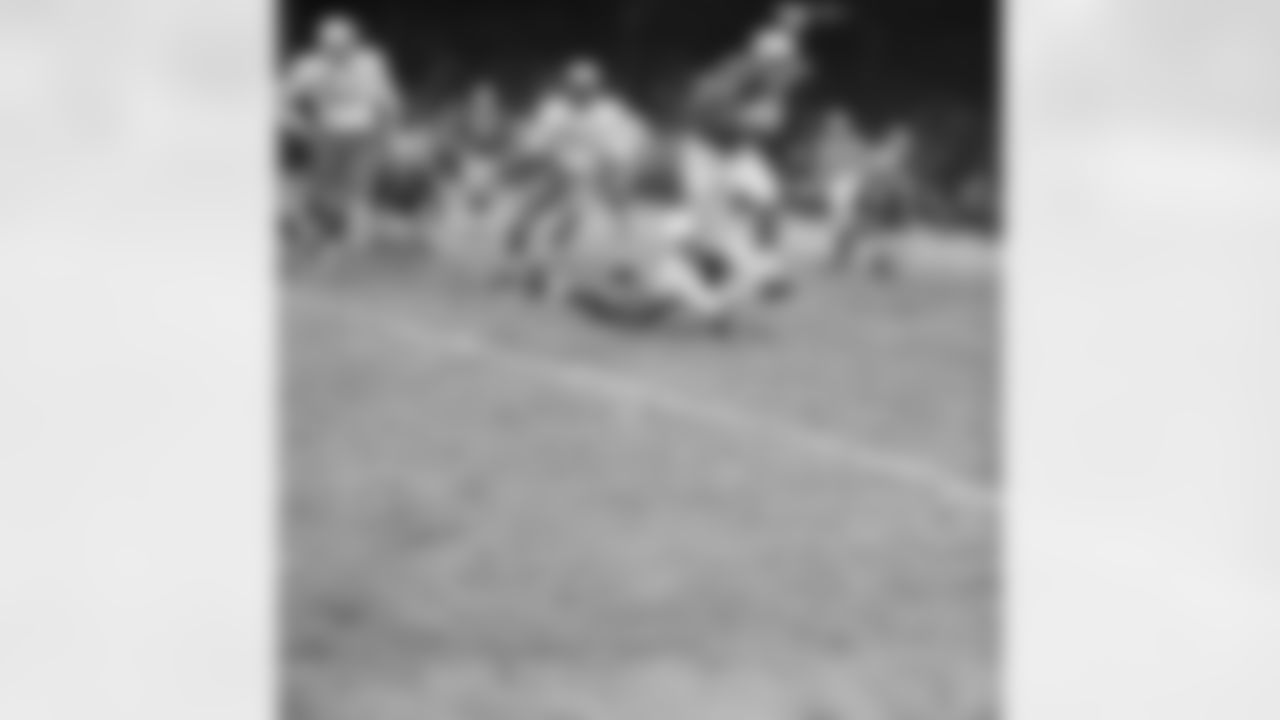 Detroit Lions halfback Dan Lewis (45) looks like he is about to be toppled by Chicago Cardinals back Jim Wagstaff (on ground), but Lewis was too fleet for him. He ran a good ten yards more in this fourth quarter play before another player nailed him. At rear is Cardinals linebacker Ted Bates (51). The Lions scored early and kept a healthy lead throughout the game to win 54-21, on Dec. 7, 1959 in Detroit. (AP Photo/AlvinQuinn)