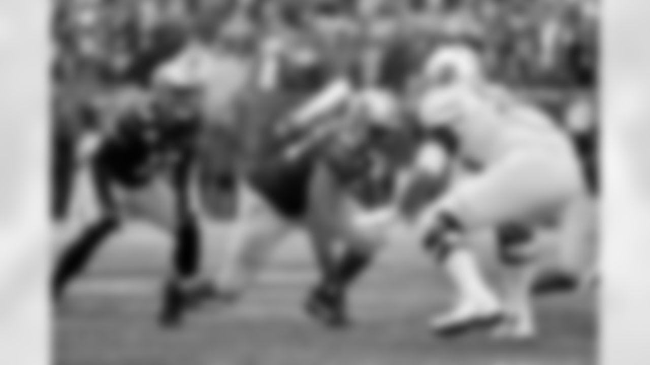 SEATTLE, WASHINGTON - OCTOBER 19: Levi Onwuzurike #95 of the Washington Huskies gets off the ball during the game against the Oregon Ducks at Husky Stadium on October 19, 2019 in Seattle, Washington. (Photo by Alika Jenner)