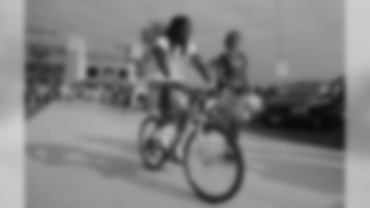 Al Harris bikes to training camp practice