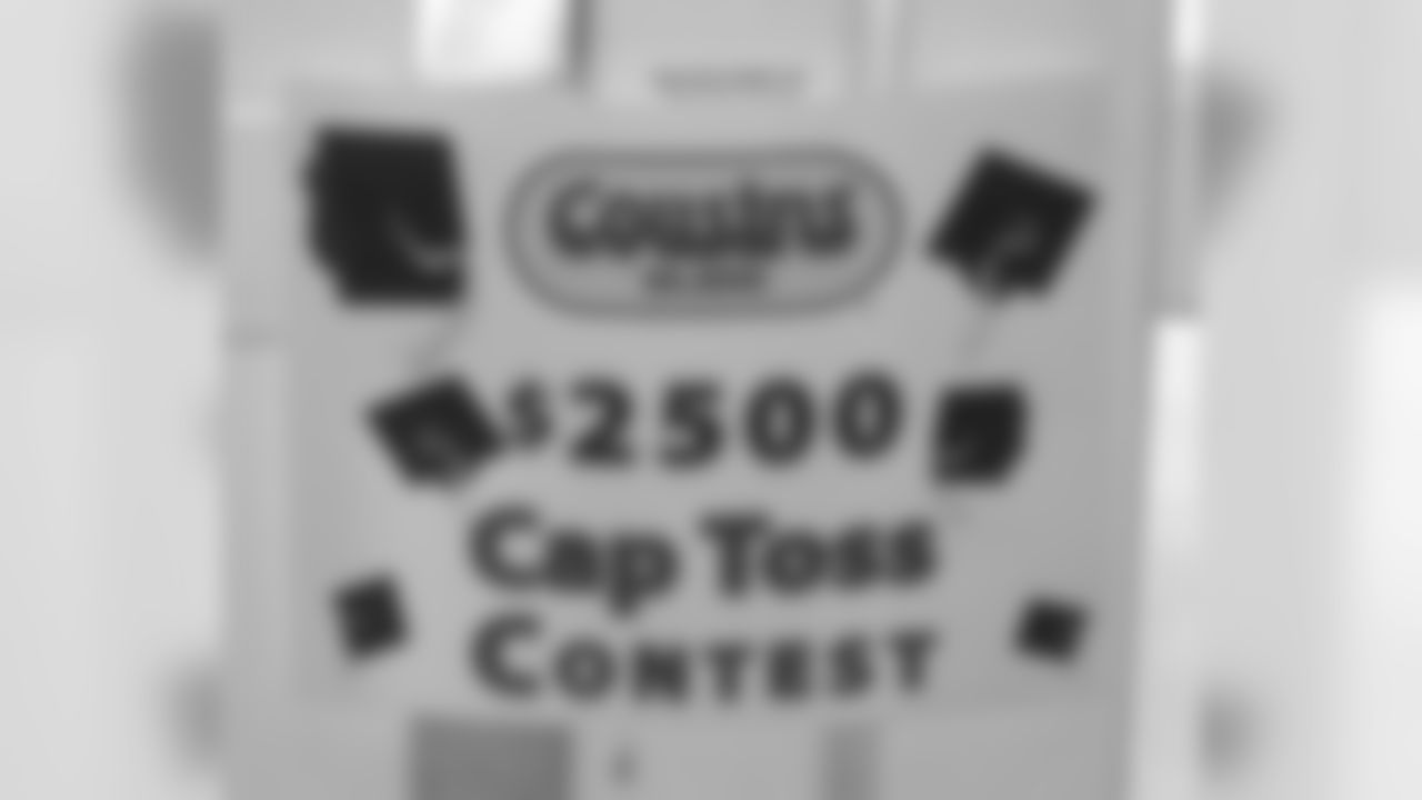 Cap Tossing Contest Held At Lambeau Field
