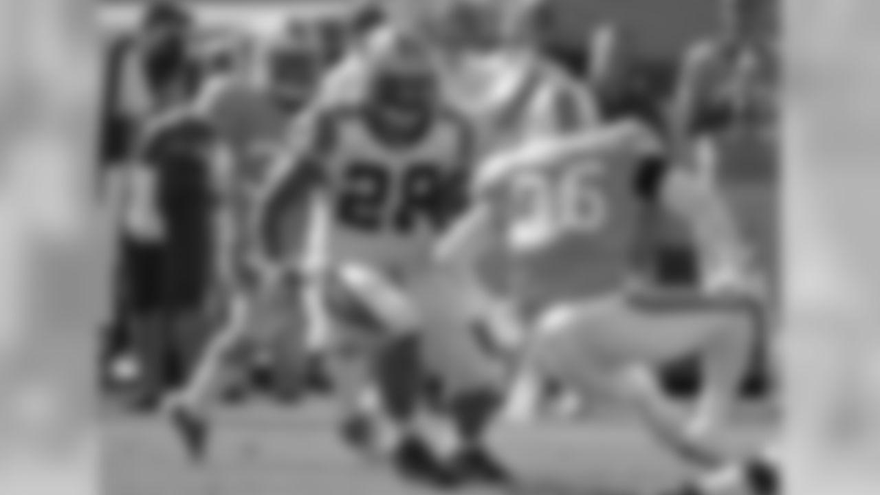 Carolina Panthers running back Jonathan Stewart (28) cuts between Tampa Bay Buccaneers defenders Elbert Mack (33) and Tanard Jackson (36) during the first quarter of an NFL football game on Sunday, Dec. 4, 2011, in Tampa, Fla. (AP Photo/Chris O'Meara)