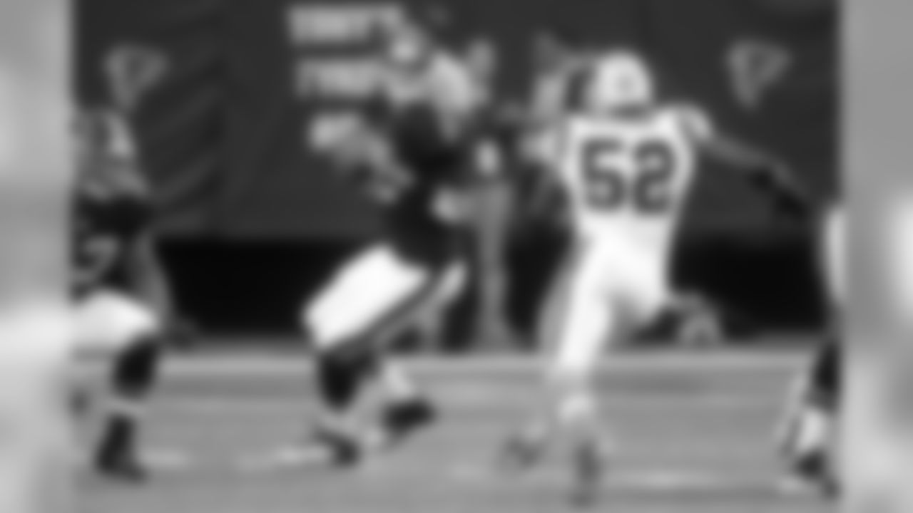 Atlanta Falcons quarterback Matt Ryan (2) looks for a receiver as Carolina Panthers middle linebacker Jon Beason (52) pursues during the first half of an NFL football game Sunday, Sept. 30, 2012, in Atlanta. (AP Photo/John Bazemore)