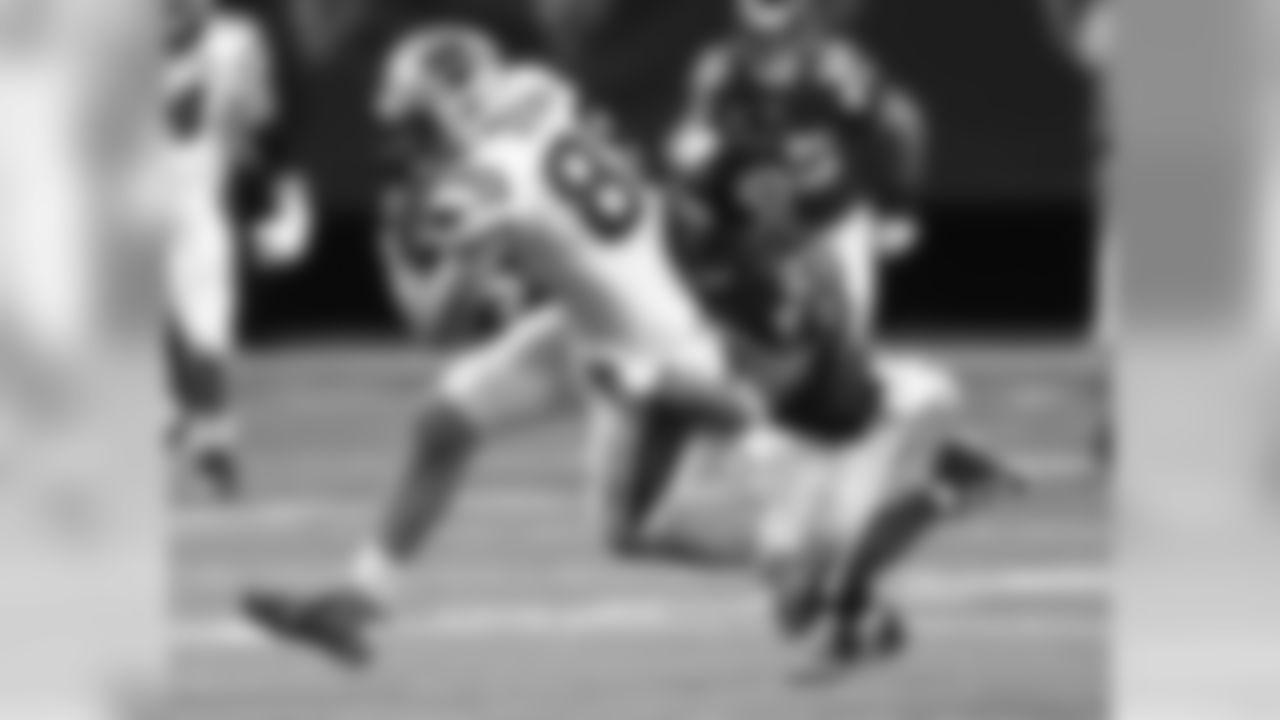 Carolina Panthers tight end Greg Olsen (88) makes the catch against Atlanta Falcons cornerback Robert McClain (27) during the first half of an NFL football game, Sunday, Dec. 28, 2014, in Atlanta. (AP Photo/John Bazemore)