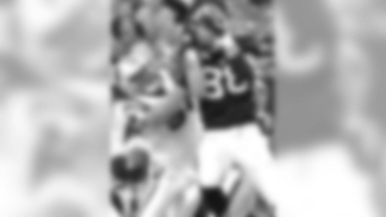 Carolina Panthers outside linebacker Thomas Williams, left, tackles Atlanta Falcons tight end Tony Gonzalez (88) during the first half of an NFL football game Sunday, Oct. 16, 2011, in Atlanta. (AP Photo/Rich Addicks)