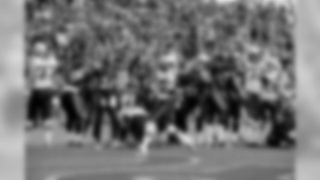 Tom Brady throws down a big spike after a touchdown run on Sunday, December 19, 2011.