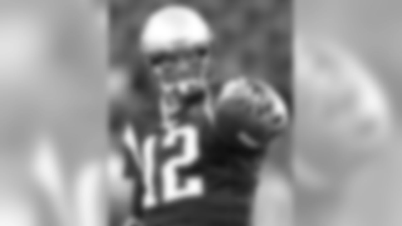 New England Patriots quarterback Tom Brady points before a NFL football game between the New England Patriots and the New York Giants at Gillette Stadium in Foxborough, Mass. Sunday, Nov. 6, 2011. (AP Photo/Winslow Townson)