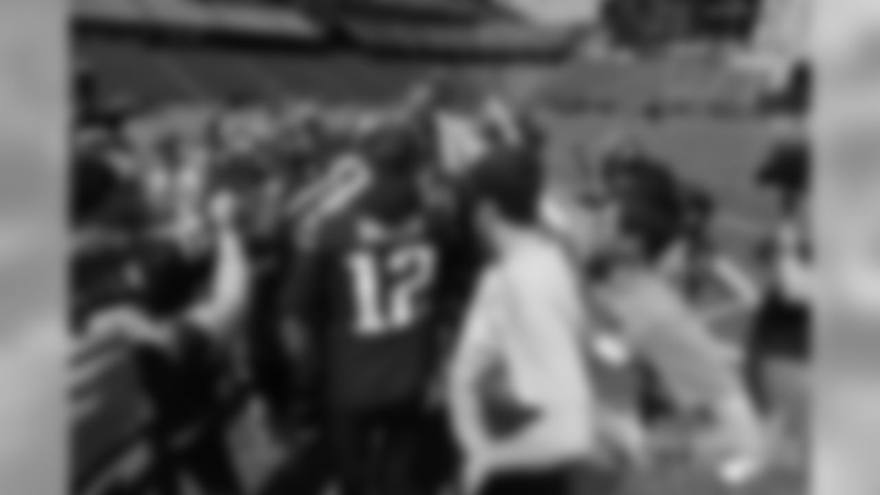 Tom Brady leads the huddle.