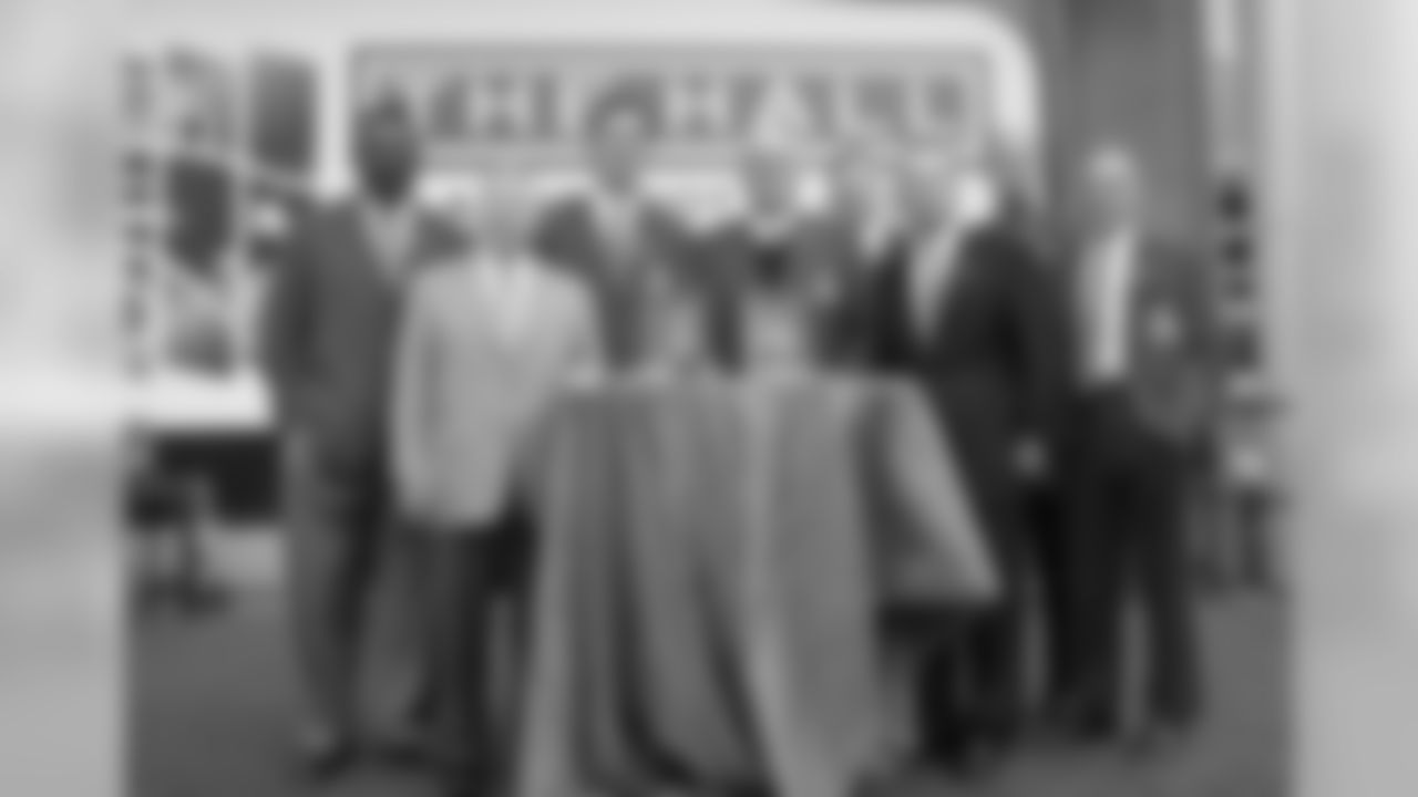 Patriots Hall of Famers Andre Tippett, Drew Bledsoe, Jon Morris, Steve Nelson, Steve Grogan & Gino Cappelletti pose for a group photo with Robert Kraft and Jonathan Kraft.