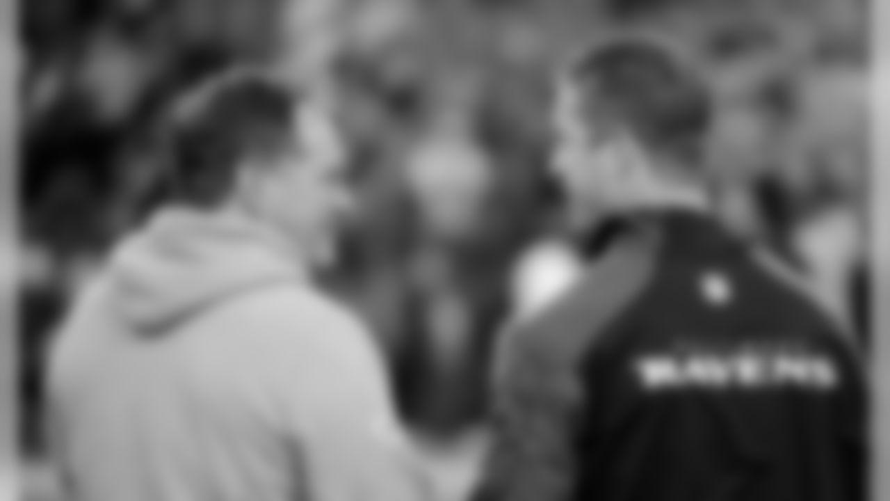 Bill Belichick talks with Ravens Head Coach John Harbaugh