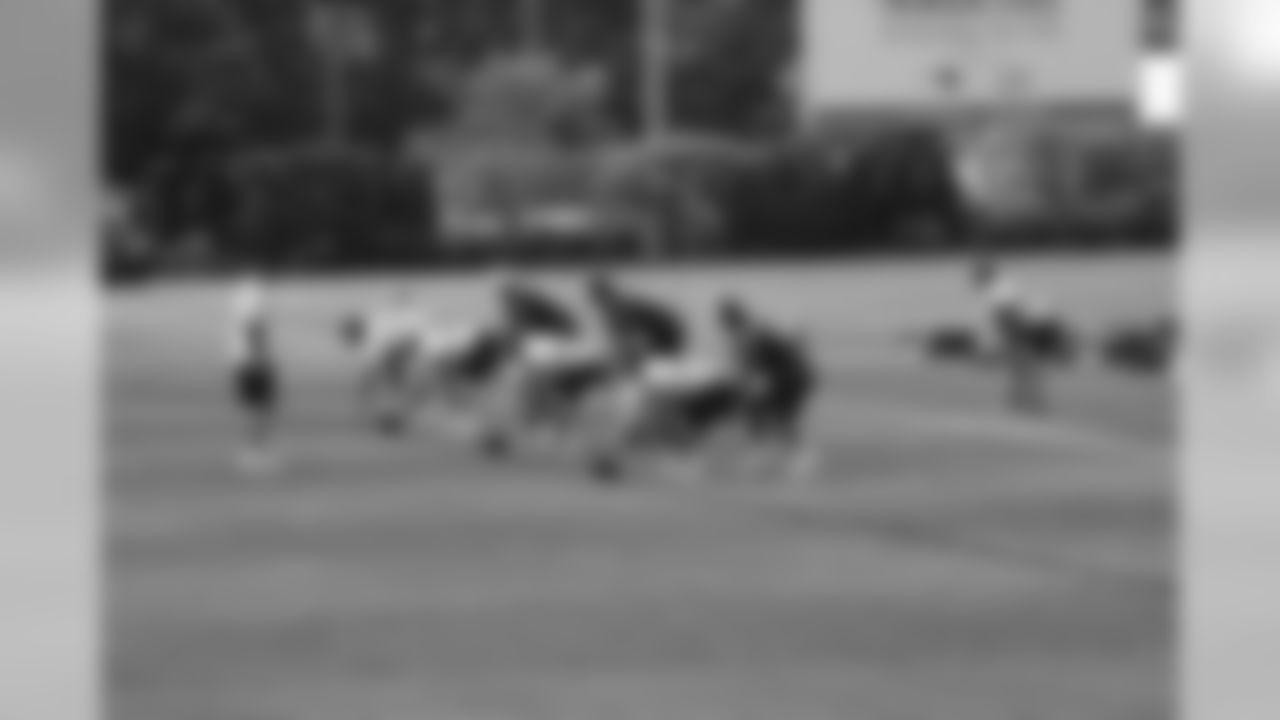 Quarterbacks taking snaps for pre-practice