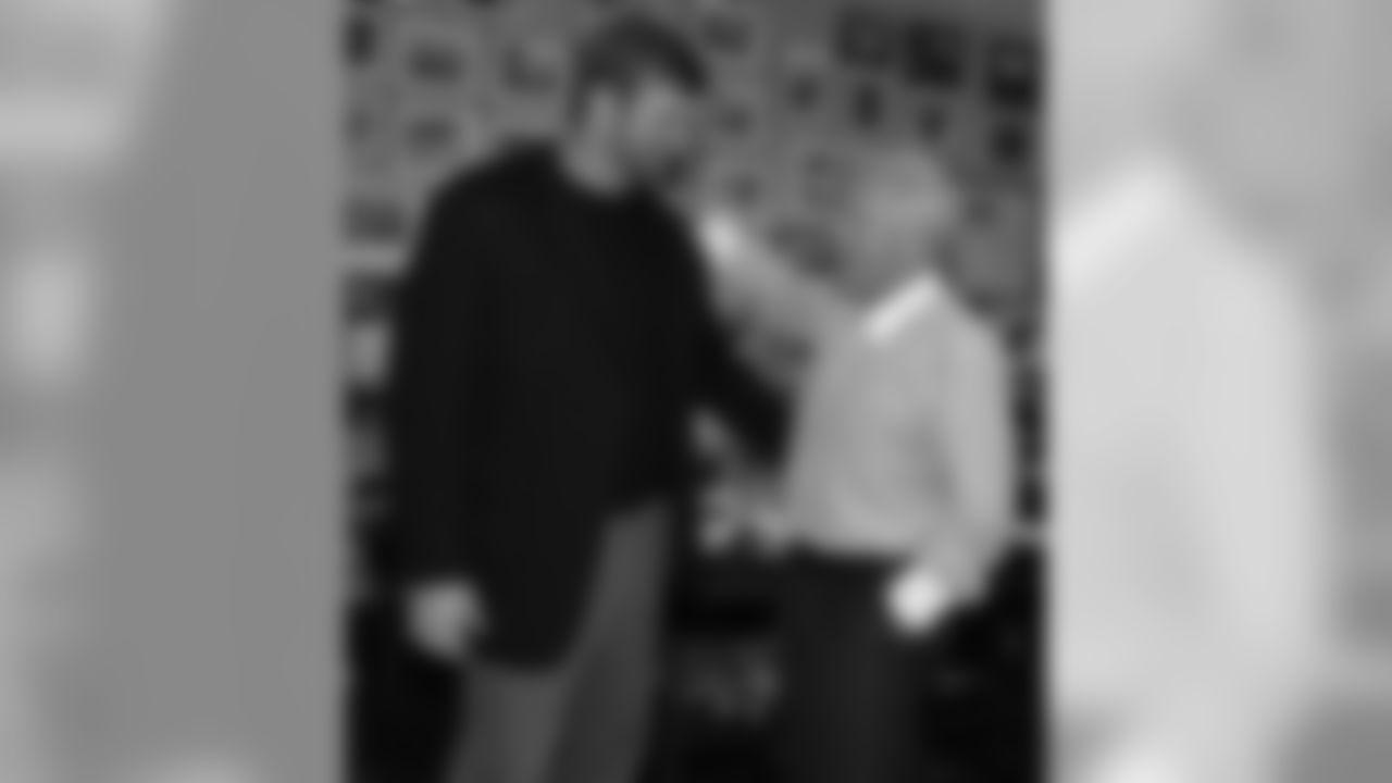 Matt Light meets with Robert Kraft before his retirement ceremony.