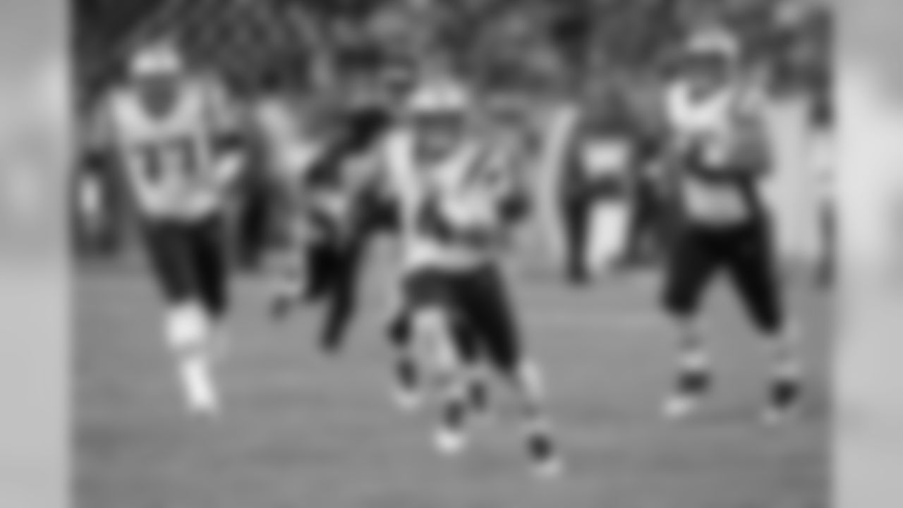 New England Patriots quarterback Jarrett Stidham (4) scrambles against the Tennessee Titans in the second half of a preseason NFL football game Saturday, Aug. 17, 2019, in Nashville, Tenn. (AP Photo/Mark Zaleski)
