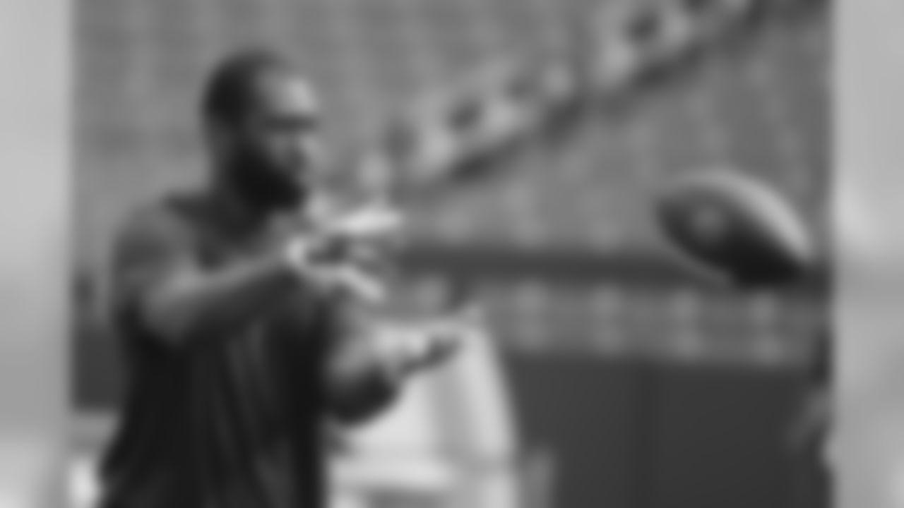 New England Patriots cornerback Darrelle Revis warms up before an NFL football preseason game against Washington Redskins in Landover, Md., Thursday, Aug. 7, 2014. (AP Photo/Alex Brandon)