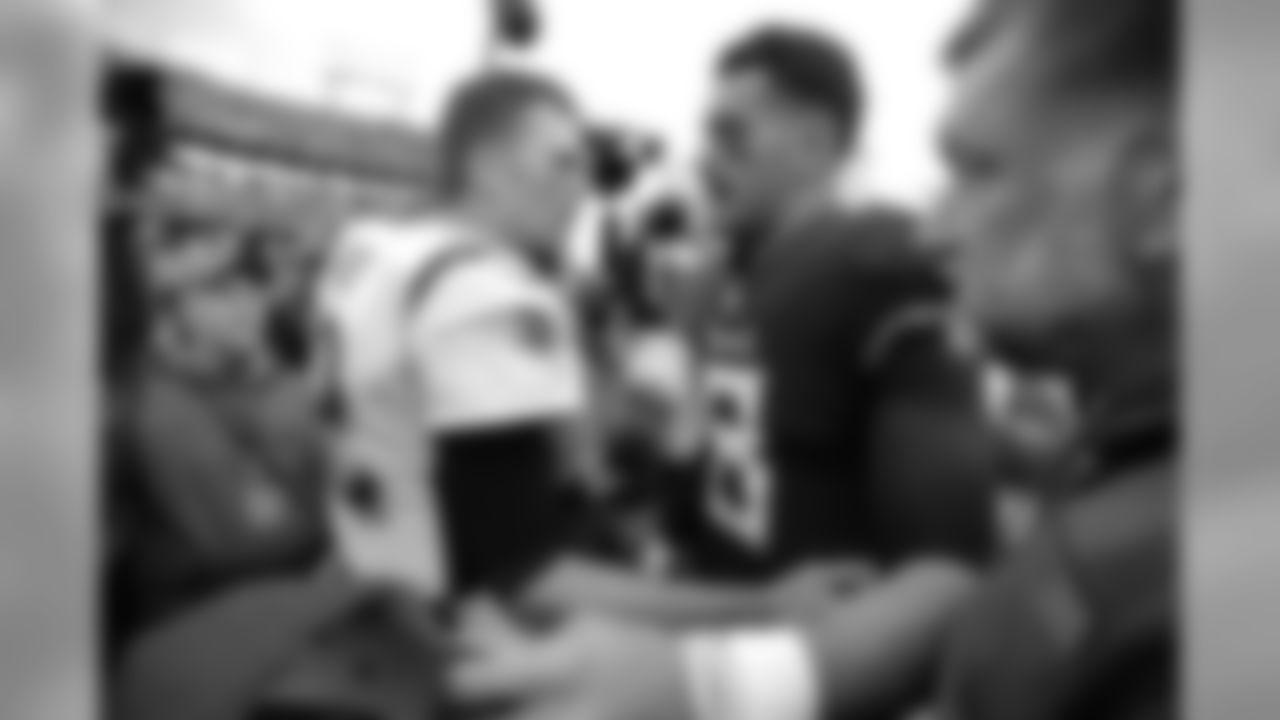 New England Patriots quarterback Tom Brady (12) congratulates Tennessee Titans quarterback Marcus Mariota (8) after an NFL football game Sunday, Nov. 11, 2018, in Nashville, Tenn. The Titans won 34-10. (AP Photo/Mark Zaleski)