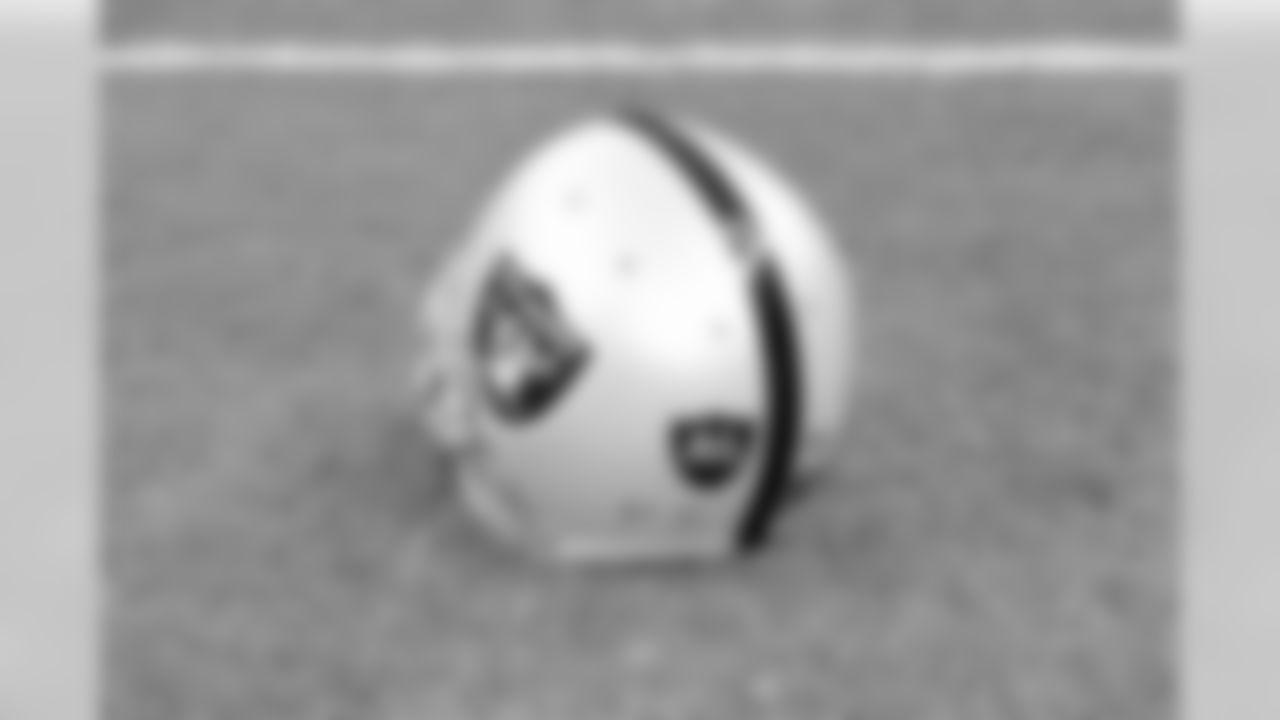 The Raiders wear AL decals on their helmets in memory of late owner Al Davis.