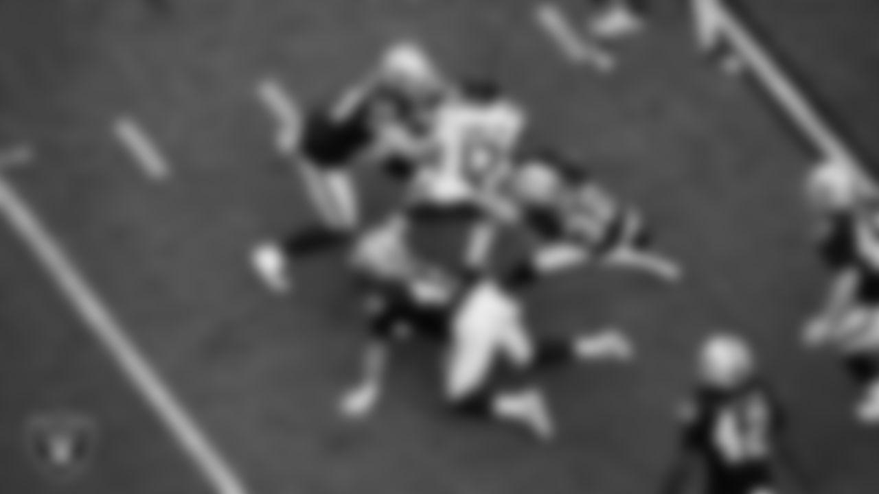 Las Vegas Raiders linebacker Nick Kwiatkoski (44), fullback Alec Ingold (45) and safety Dallin Leavitt (32) make a tackle during the regular season home game against the Chicago Bears.