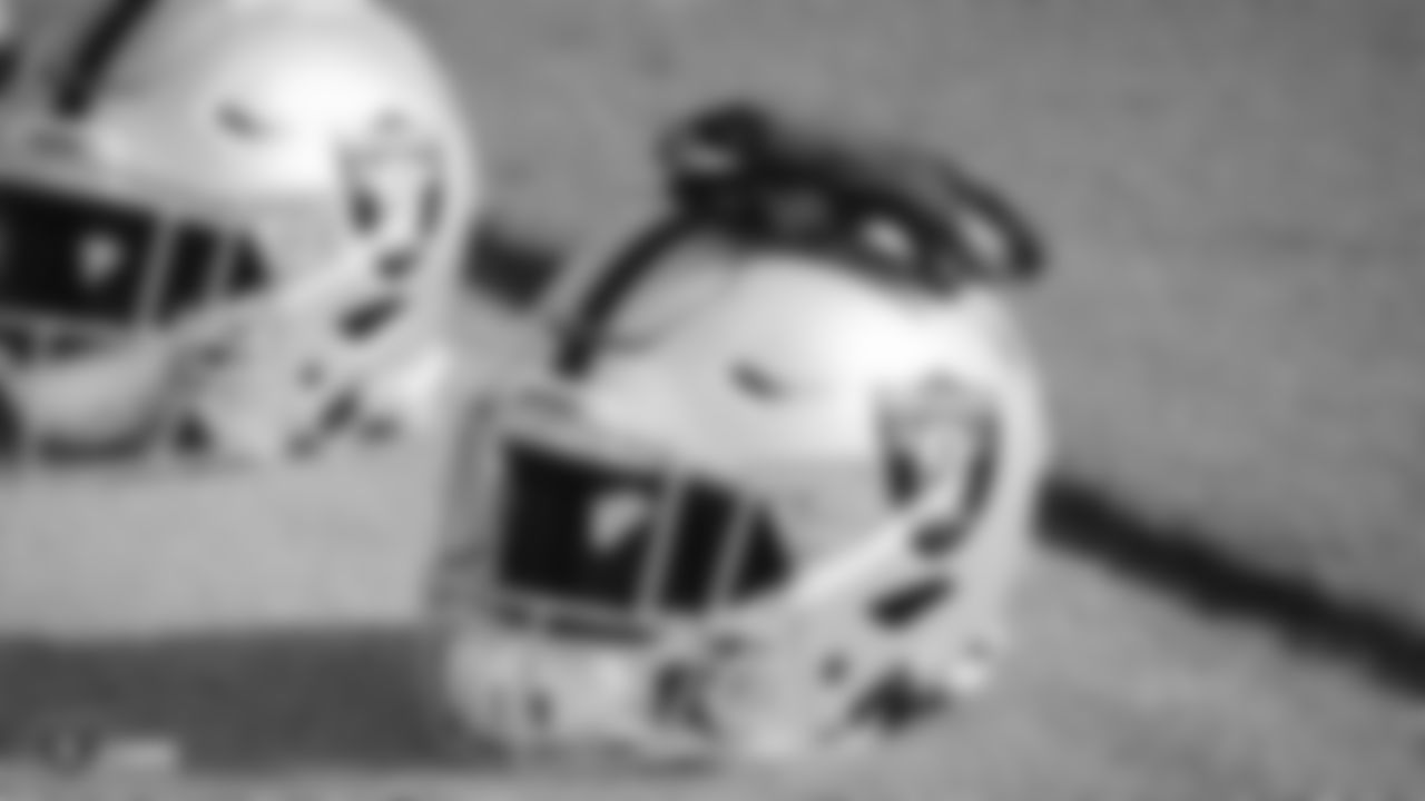 A Raiders helmet and gloves during practice.