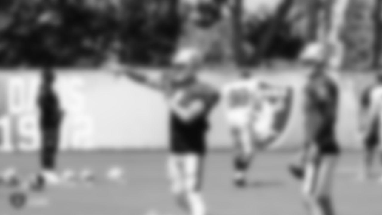 Oakland Raiders quarterback Derek Carr (4) and quarterback AJ McCarron (2) on the field for practice at the Oakland Raiders Practice Facility, Wednesday, September 5, 2018, in Alameda, California.