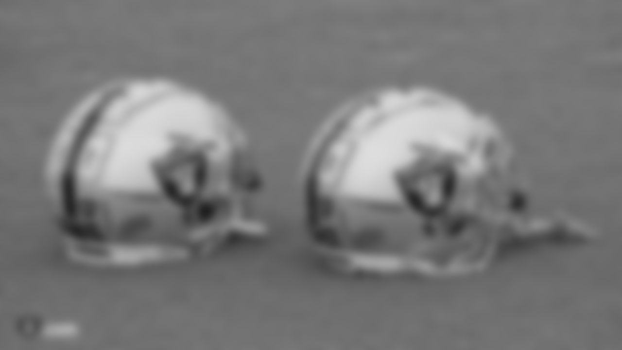 Raiders safety Curtis Riley's (35) and cornerback Dylan Mabin's (37) helmets on the field for practice.