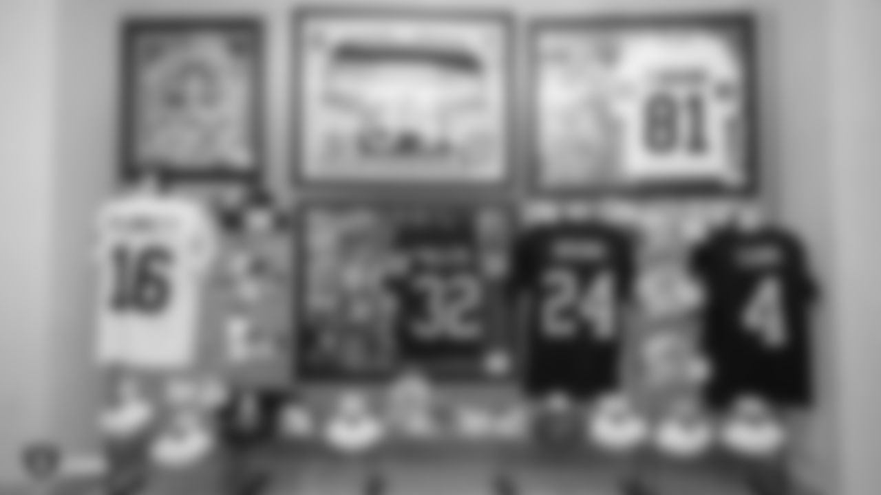 Raiders items are displayed as part of the silent action during the Raiders Foundation Charity Poker Tournament.