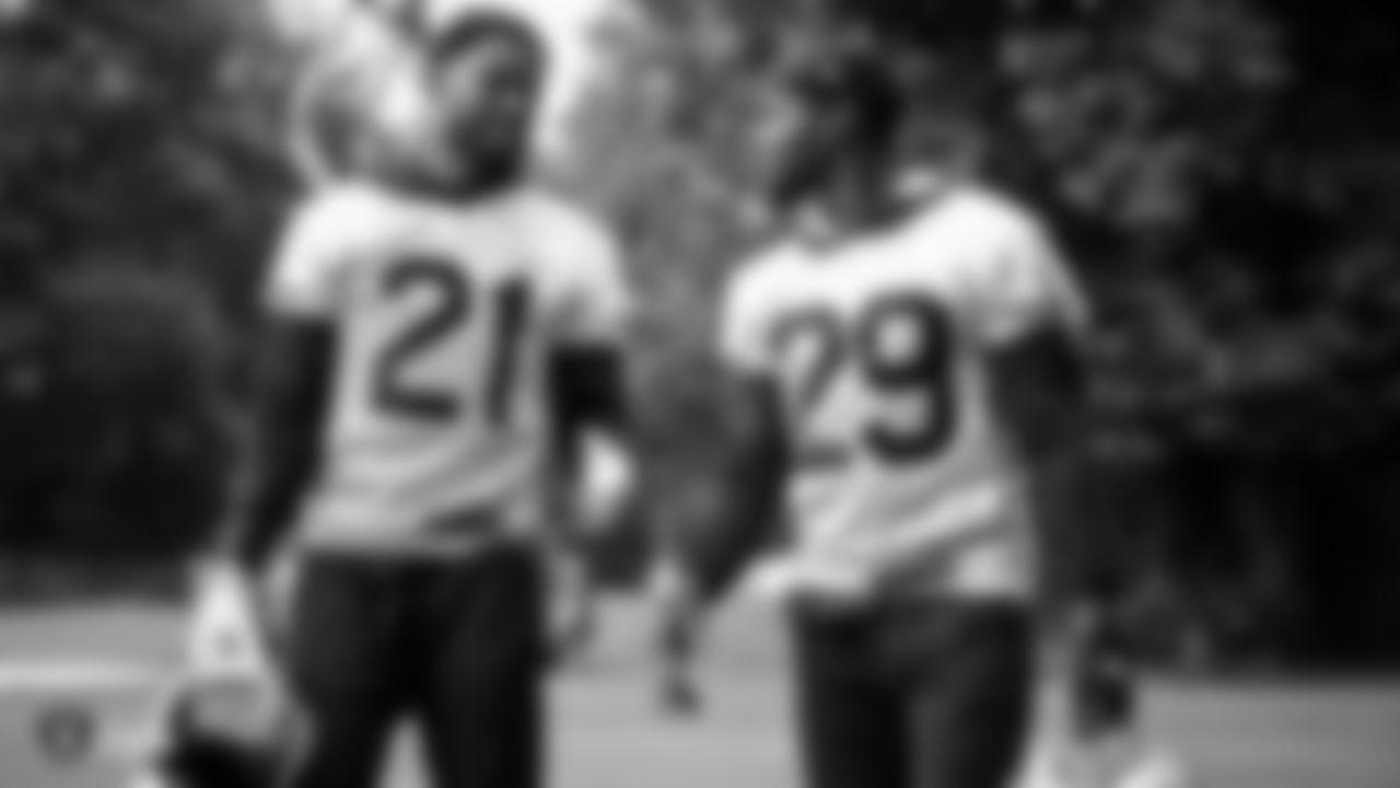 Raiders cornerback Gareon Conley (21) and safety Lamarcus Joyner (29) talk on the field during practice.