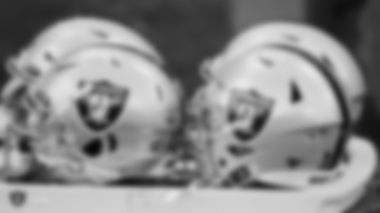 Raiders helmets on the field during practice.