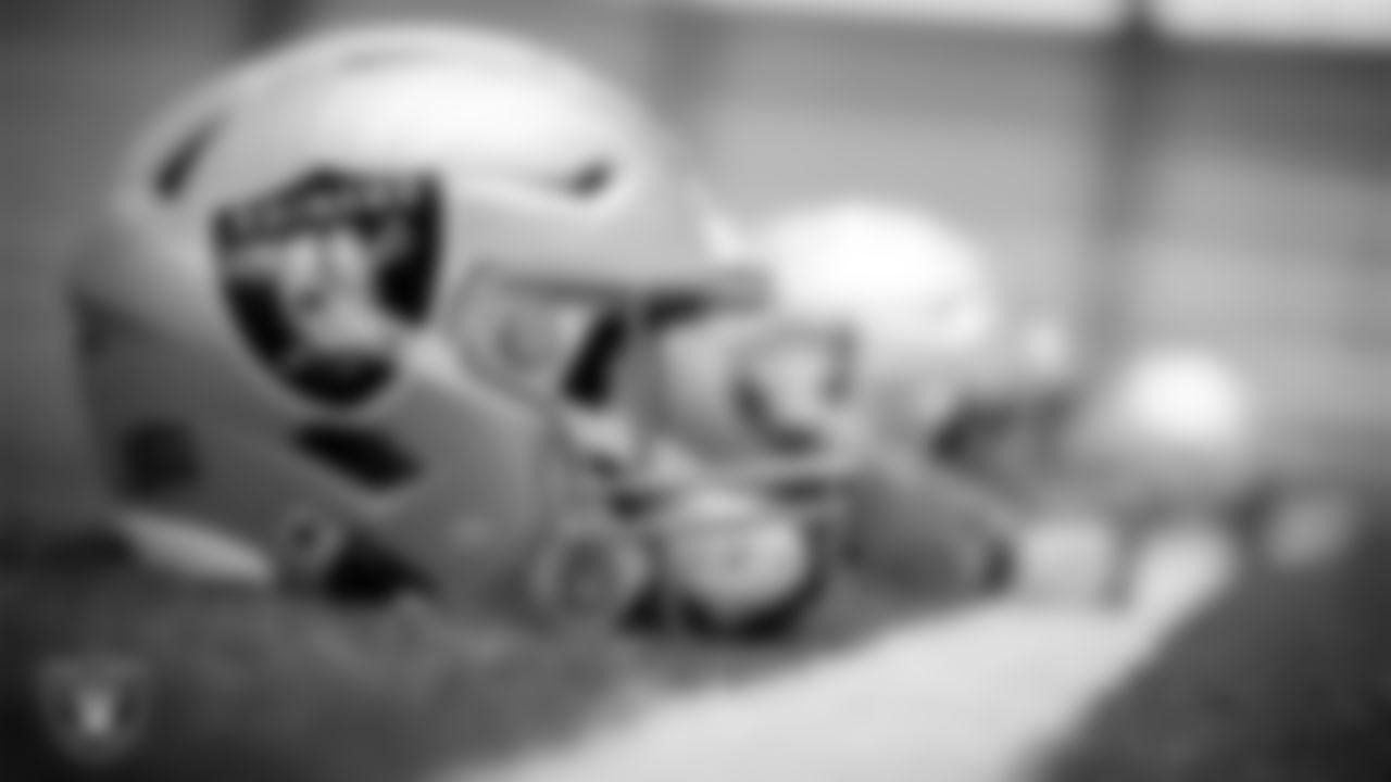Las Vegas Raiders helmets on the field during practice.