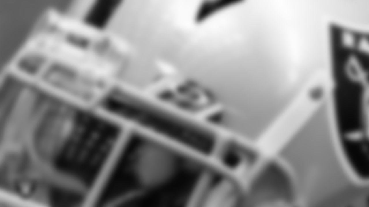 A Las Vegas Raiders helmet on the field during a walkthrough.