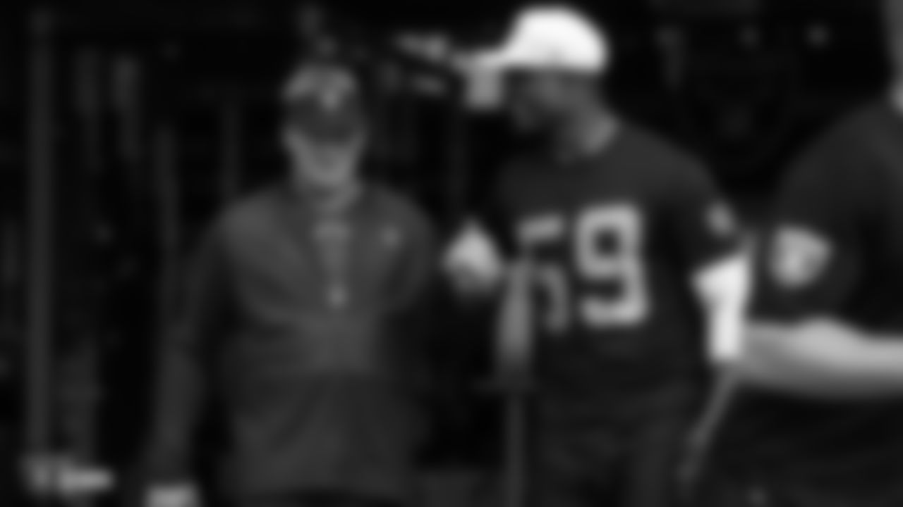 Head coach Jon Gruden and linebacker Tahir Whitehead make their way to the practice field for an offseason workout at Raiders HQ on Monday, May 6, 2019.
